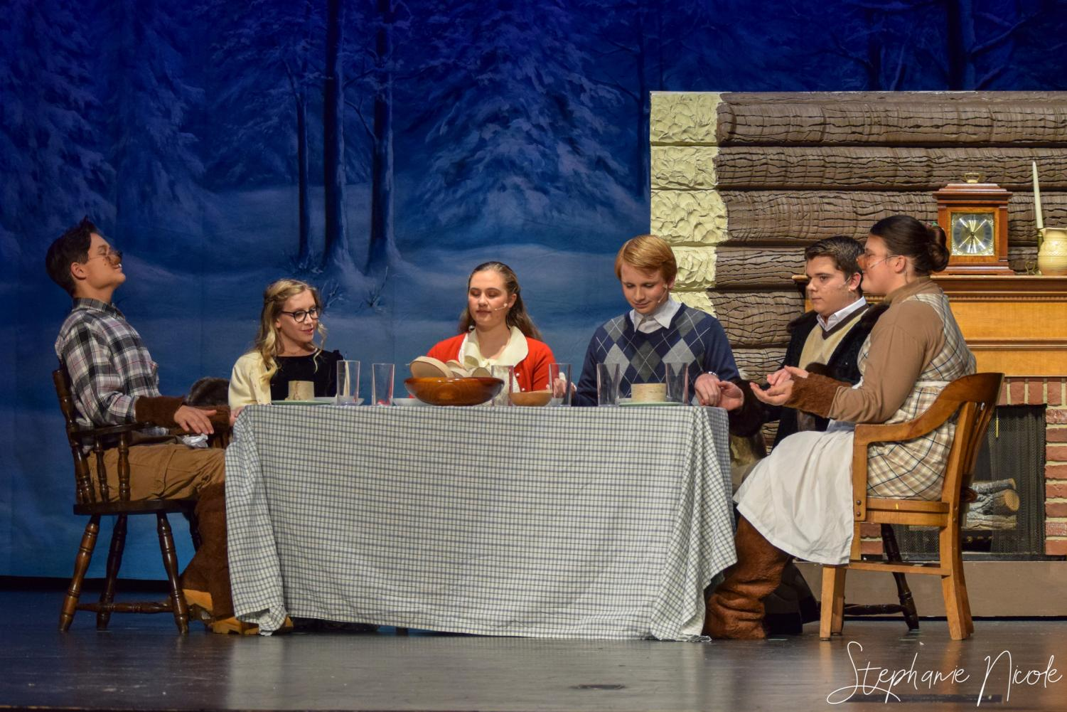 Junior Harry Pala, senior Emma Loomis, juniors Jackie Bobos and Tyler Smith, sophomore Kyle Rassel, and freshman Genesis Sandoval sit during a scene at the Beaver house.