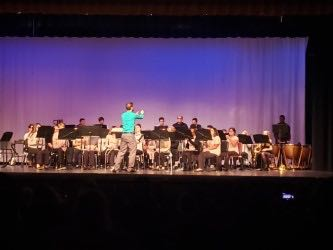 Aaron Alexander conducts the Symphonic Band.