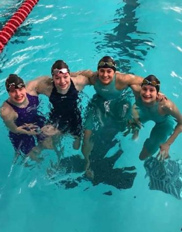Girls Swim Breaks Records in Sectionals