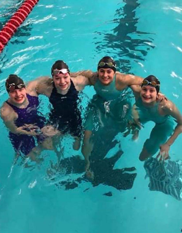 Girls Swim Breaks Records in Sectionals